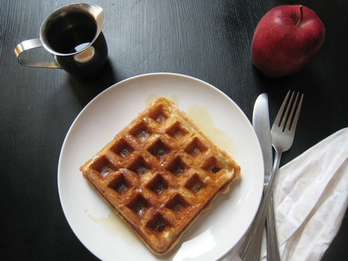 cinnamon waffle on a plate with syrup