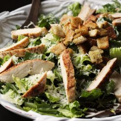 A plate of chicken caesar salad