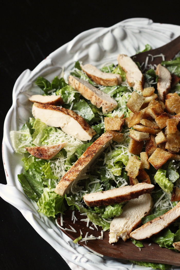large serving bowl of chicken caesar salad