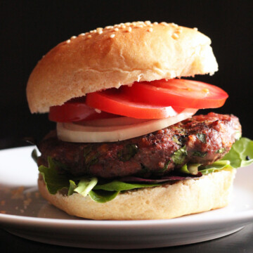 A close up of a burger on a plate