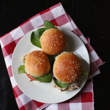 A plate of pulled chicken sliders