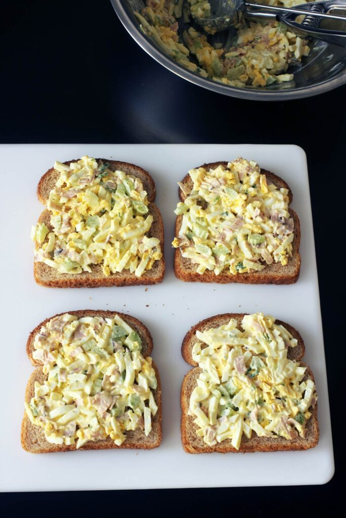 salad spread on four slices of bread