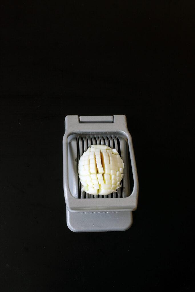 egg cut in crosshatches on slicer