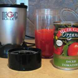can of tomatoes on counter with magic bullet