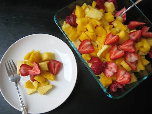 A bowl and plate of Fruit salad