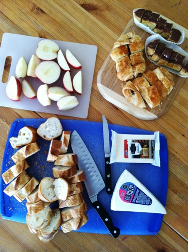 platters of apples, bread, and cheese