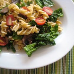 A bowl of spinach and pasta