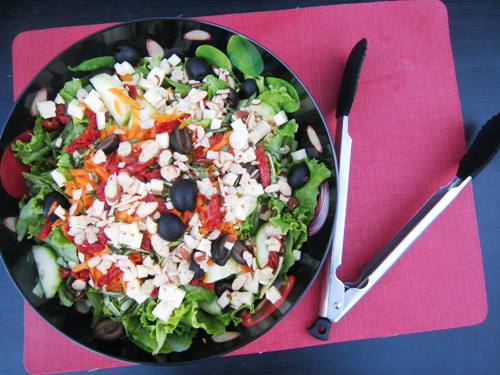 green salad with sundried tomatoes and pepper jack