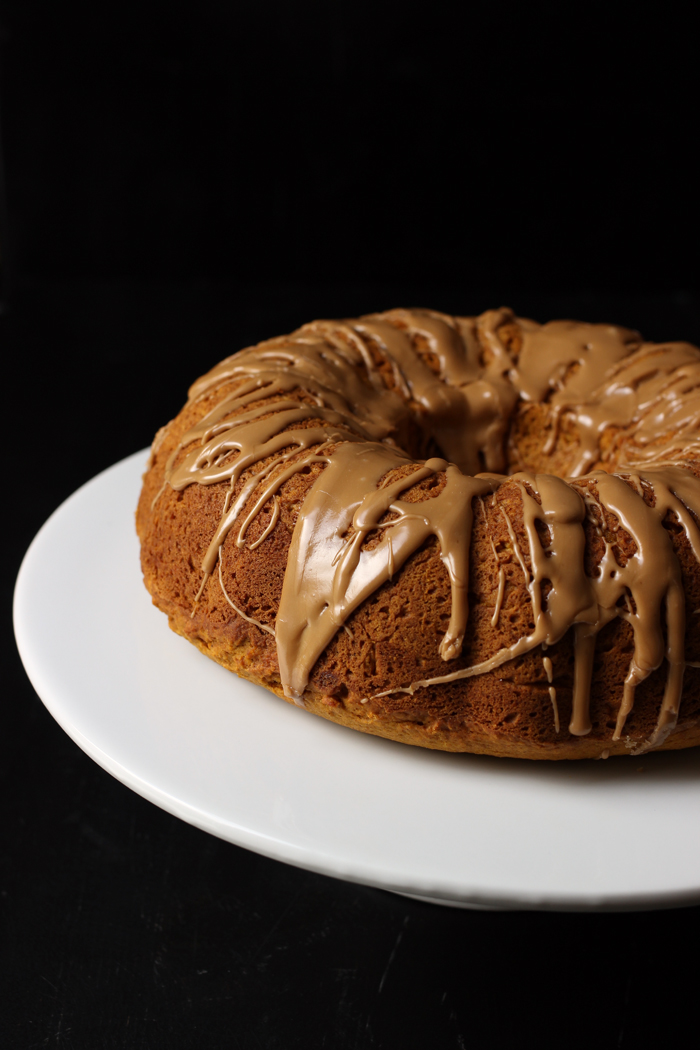 Pumpkin Bundt cake with Maple Glaze on cake stand