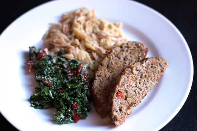 A plate of with meatloaf, greens, and rice