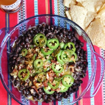 beans, bacon, and jalapeños in pan for nachos