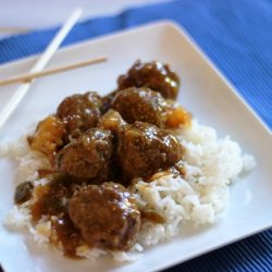 A plate of rice and meatballs