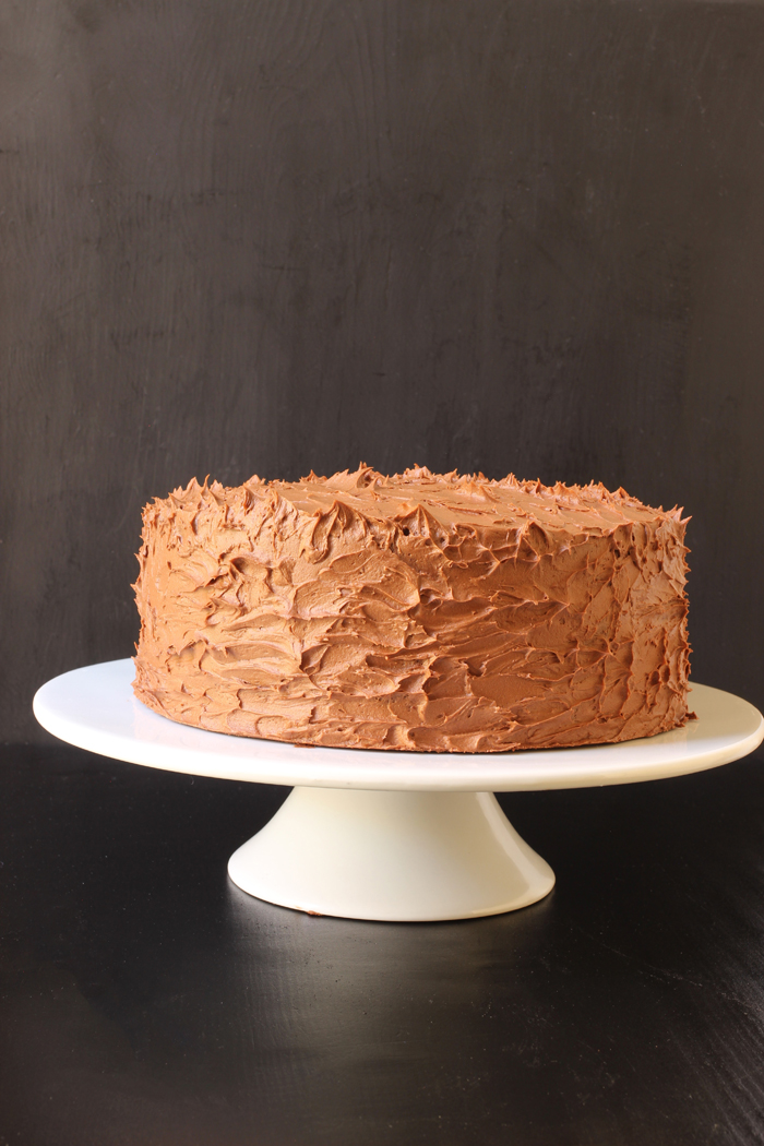 cake with chocolate buttercream on cake stand