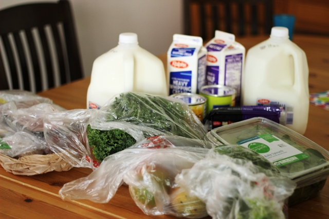 milk and other groceries on table