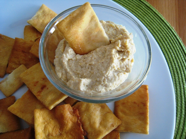 A plate of hummus and pita chips