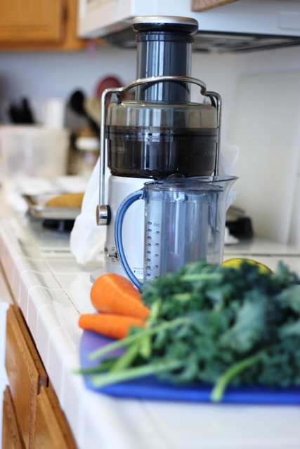 juicer on counter with fresh produce