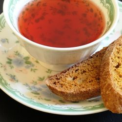 A cup of tea with Pumpkin biscotti on saucer
