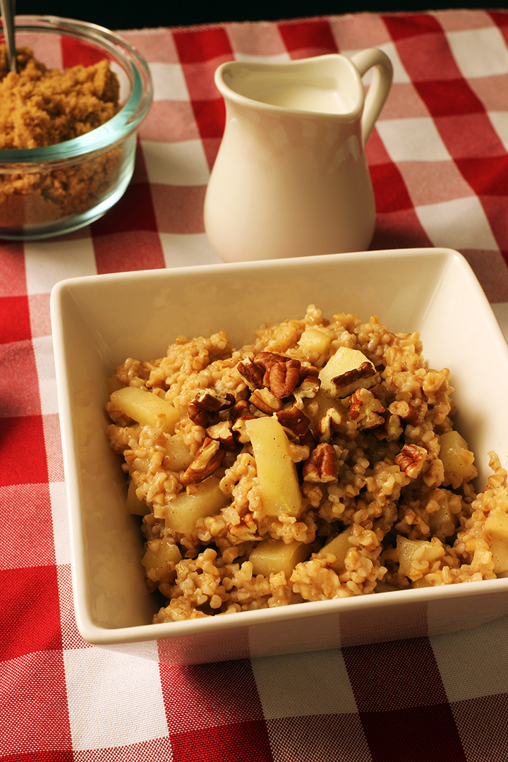 bowl of apple oatmeal with nuts and sugar