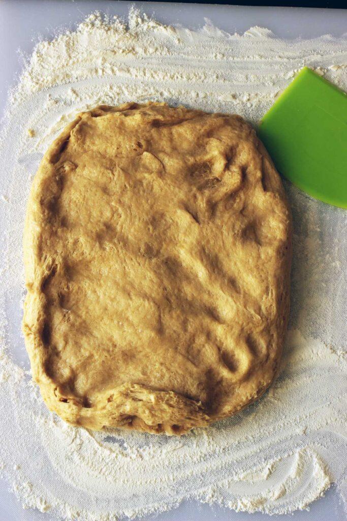 flattened dough on board