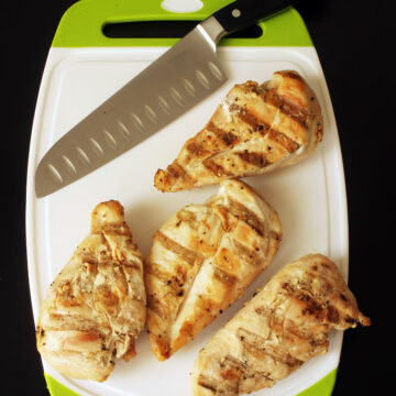 grilled chicken on cutting board