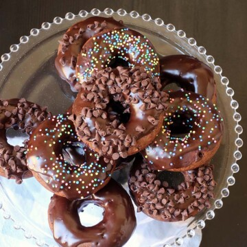 stack of chocolate donuts on glass beaded stand