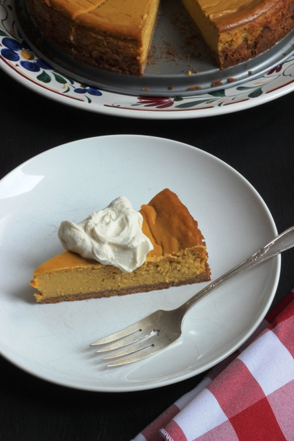 A slice of Pumpkin Cheesecake on a plate, with fork