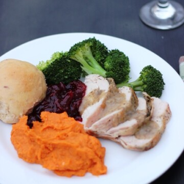 A plate of Thanksgiving food with turkey and gravy