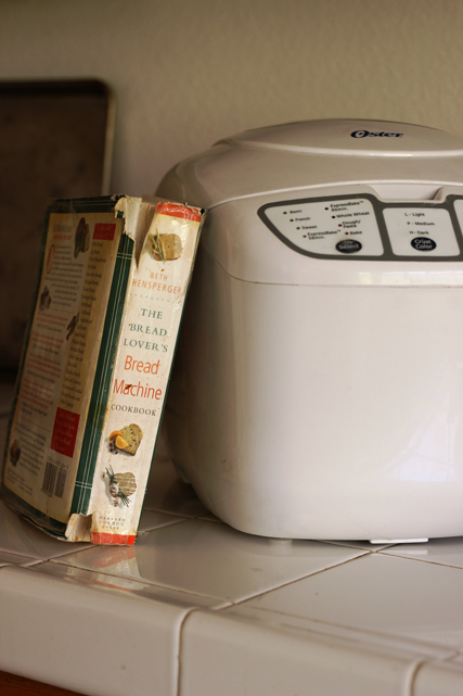 Bread machine and Cookbook on counter