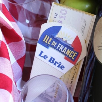 paper cutout of Brie cheese in gift basket