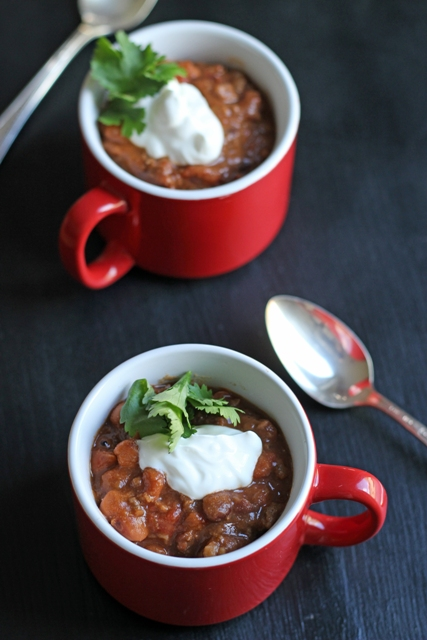 This Easy Slow Cooker Chili really is easy. Cook up meat and onions, open some cans, dump some spices, and walk away.