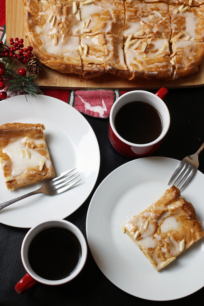cut kringle pieces on plates with coffee
