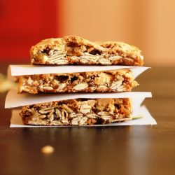 pepita bars stacked on top of a wooden table
