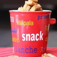 A close up of a snack jar with cinnamon toast croutons