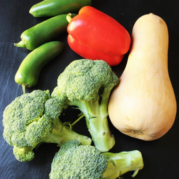 broccoli peppers and squash on table