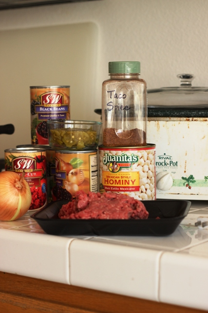 cans and ground beef on counter by crockpot