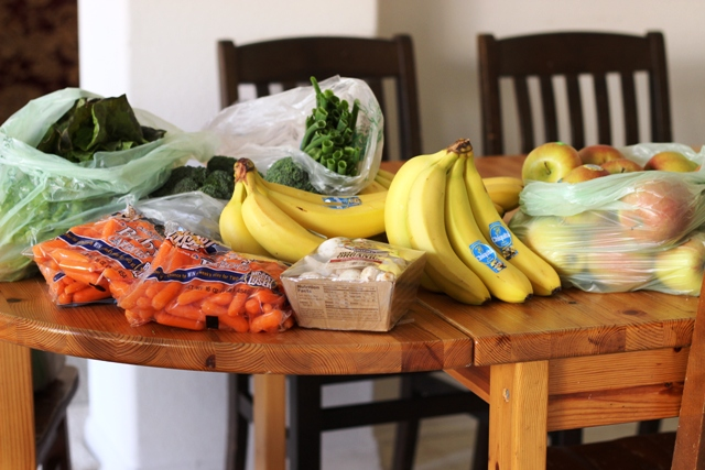 bananas and other groceries on a wooden table