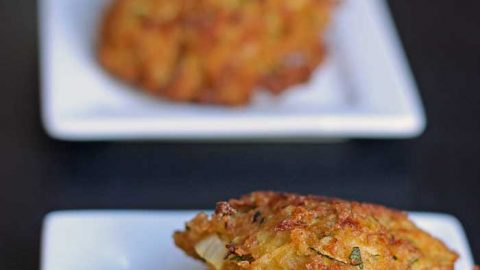 zucchini fritters on tasting plates