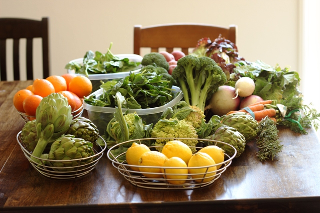 baskets of fruit and vegetables on table
