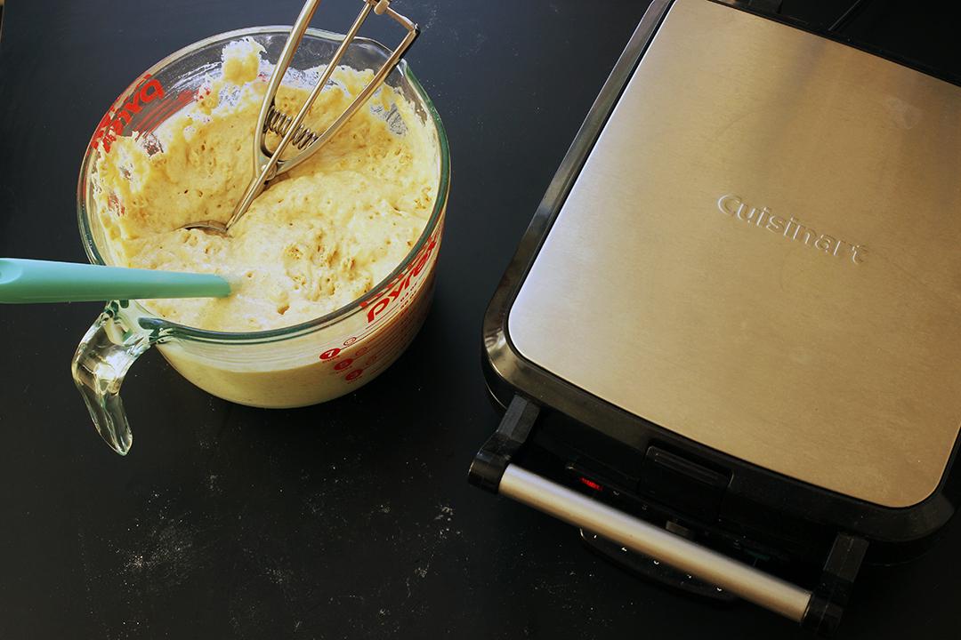 waffle batter next to cuisinart waffle maker