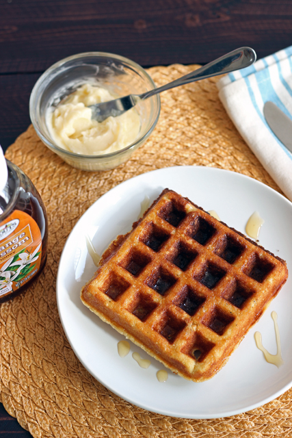 Buttermilk Corn Waffles - Celebrate a bright new day with these tangy buttermilk corn waffles. Gild the lily with a little honey butter.