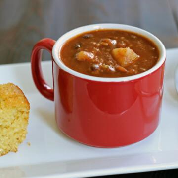 A close up of mug of chili bean soup