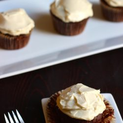 Maple-Sweetened Chocolate Cupcakes with Honey Cream Cheese Frosting - Enjoy a naturally sweet treat in these chocolate cupcakes with honey cream cheese frosting.