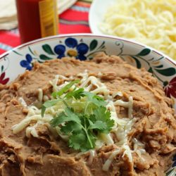 "Healthier Refried Beans - Cook up a pot of healthier ""refried"" beans to serve as a side dish, to fill burritos, or to top nachos."