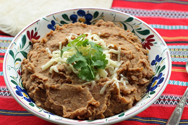 "Cook up a pot of healthier ""refried"" beans to serve as a side dish, to fill burritos, or to top nachos."
