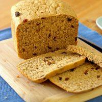 slicing a loaf of Raisin Bread