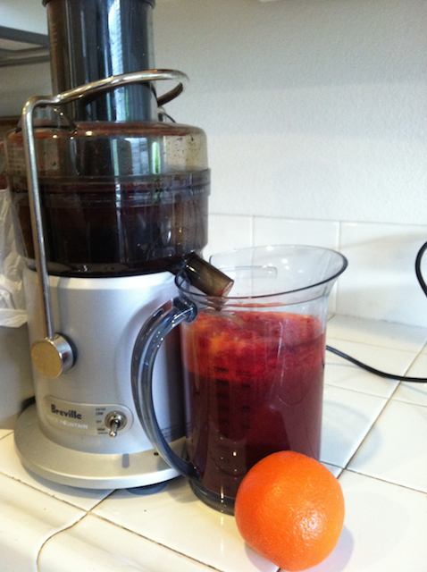homemade juice in pitcher by juicer
