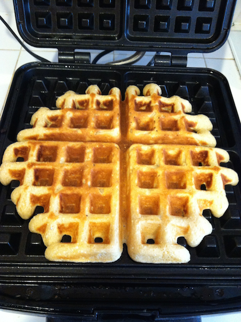 waffles cooking in waffle maker
