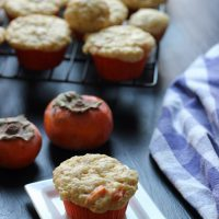 A tray of muffins on a table, with Muffin and Persimmon