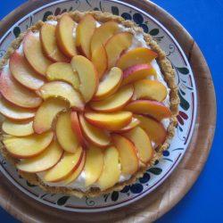 platter with a cream cheese nectarine tart
