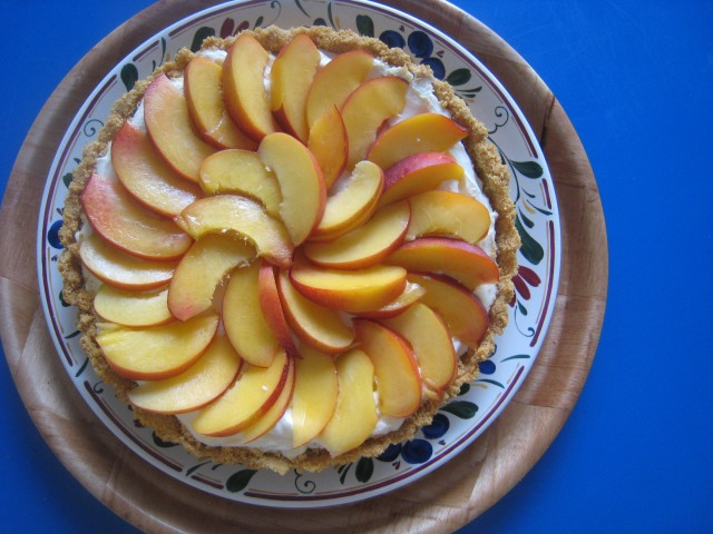 Cream Cheese and Nectarine Tart - Enjoy the wonderful flavor of summer stone fruit in this cream cheese tart with nectarines.